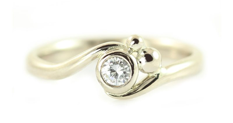 Delicate curvy white gold diamond engagement ring